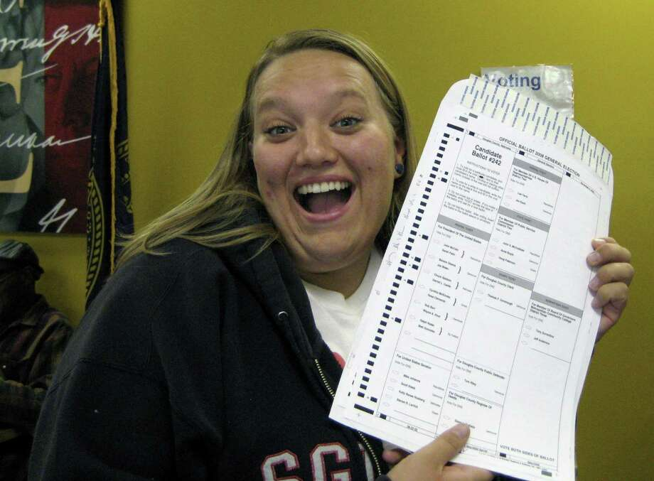 In this Oct. 20, 2008, photo provided by Nikola Halycyone Jordan, Jordan poses with her election ballot in Omaha, Neb. Jordan believes the selfies are a great way not only to share her views on the issues, but also to stress the importance of voting and being civically active. A Nebraska lawmaker added a provision to state election law in 2016 to allow ballot selfies. (Mari Zaporowski/Courtesy of Nikola Halycyone Jordan via AP) Photo: Mari Zaporowski / Associated Press / Mari Zaporowski