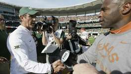 Texas coach Charlie Strong (right) and Baylor coach Art Briles shakes hands after the game on Dec. 5, 2015, in Waco. Texas won 23-17.