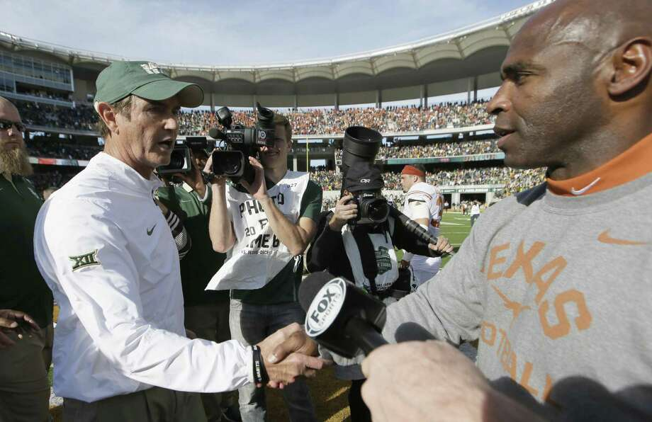 Texas coach Charlie Strong (right) and Baylor coach Art Briles shakes hands after the game on Dec. 5, 2015, in Waco. Texas won 23-17. Photo: LM Otero /Associated Press / AP