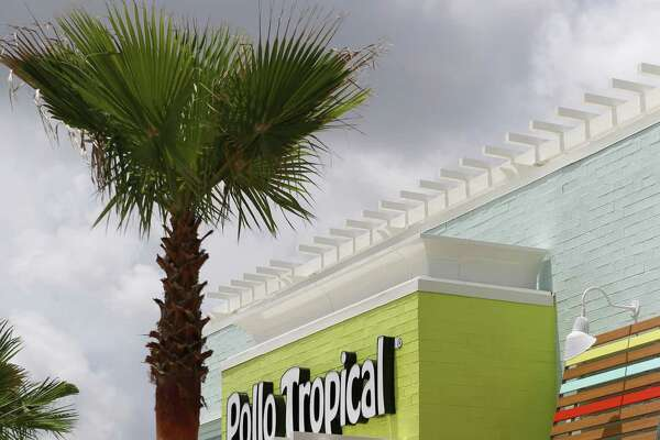 The outside of Pollo Tropical, 11400 Broadway, shown Tuesday, July 8, 2014, in Pearland. Fiesta Restaurant Group Inc., the restaurant's parent company, plans to close 10 locations and convert three to Taco Cabana restaurants.