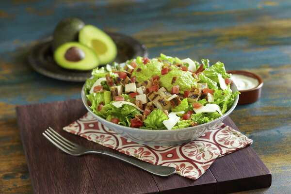 Pictured, the Chicken Avocado Salad dish at Pollo Tropical. Comparable restaurant sales at Pollo Tropical, the figure used to measure performance of retail and restaurant locations, fell by 1 percent during the three month period ending Oct. 2.