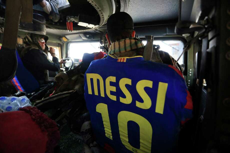 A member of Iraq's elite counterterrorism forces wears Barcelona shirt, in their armored vehicle as they patrol in Bartella, Iraq, Sunday, Oct. 23, 2016. Iraqi forces retook Bartella, around 15 kilometers (9 miles) east of Mosul, earlier this week. (AP Photo/Khalid Mohammed) Photo: Khalid Mohammed, STF / Copyright 2016 The Associated Press. All rights reserved.