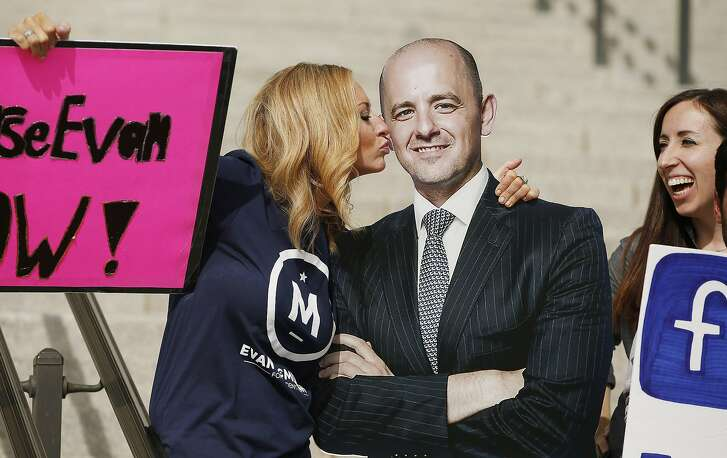 In this Oct. 13, 2016, file photo, Brynnley Pyne pretends to kiss a cardboard cutout of Evan McMullin as McMullin supporters rally at the Utah State Capitol in Salt Lake City. Two months after he jumped into the presidential race as a political unknown and fringe candidate, McMullin is surging in the polls in Utah and drawing large crowds at rallies as he becomes the conduit for conservative voters fed up with Republican Donald Trump's crudeness and antics. (Jeffrey D. Allred/The Deseret News via AP, File)