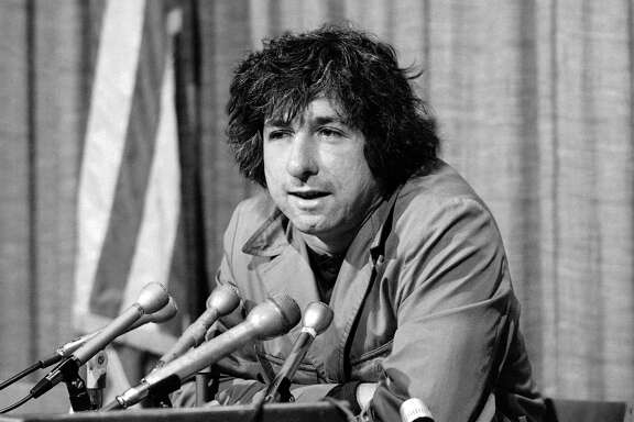 FILE - In this Dec. 6, 1973 file photo, political activist Tom Hayden, husband of Jane Fonda, tells newsmen in Los Angeles that he believes public support was partially responsible for the decision not to send him and others of the Chicago 7 to jail for contempt. Hayden, the famed 1960s anti-war activist who moved beyond his notoriety as a Chicago 8 defendant to become a California legislator, author and lecturer, has died. He was 76.  (AP Photo/George Brich, File)