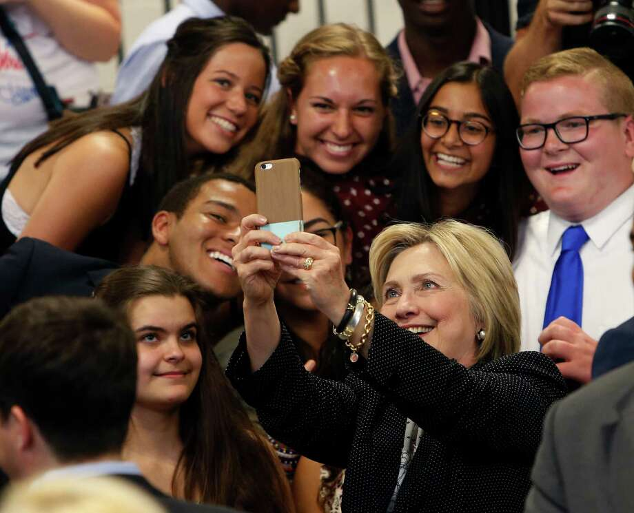 FILE - In this June 21, 2016 file photo, Democratic presidential candidate Hillary Clinton takes a photo with supporters after speaking at Fort Hayes Vocational School in Columbus, Ohio. A new poll finds that young voters are starting to come through for Clinton, particularly among whites ages 18 to 30. In the final days of the campaign, Clinton is shored up what was once a troubling weakness in a key voting bloc, a sign of strength that helps explain how the former secretary of state may be able to expand her campaign into traditionally Republican states. (AP Photo/Jay LaPrete, File) Photo: Jay LaPrete, FRE / FR52593 AP