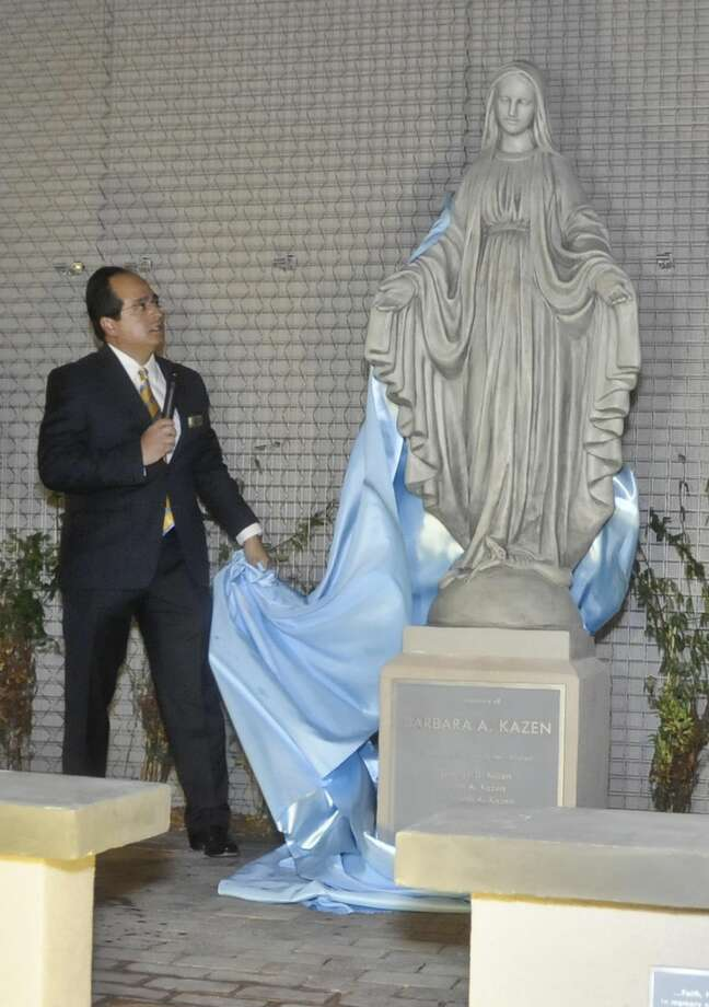 In this 2014 file photo, Jose Ceballos unveils a statue erected in memory of Barbara Kazen during a dedication ceremony for a new Bethany House center named in her honor. Ceballos said that Laredo Housing Authority staff members will need to reapply following a restructure of their organization April 1.