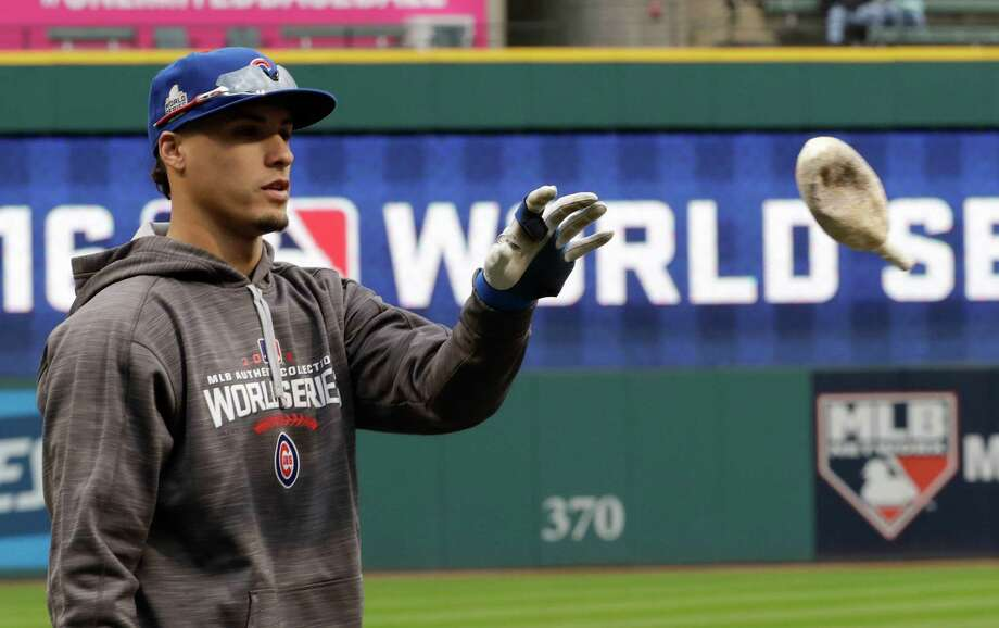 Chicago Cubs third baseman Javier Baez warms up during a team practice for baseball's upcoming World Series against the Cleveland Indians on Monday, Oct. 24, 2016 in Cleveland. (AP Photo/David J. Phillip) Photo: David J. Phillip, STF / Copyright 2016 The Associated Press. All rights reserved.