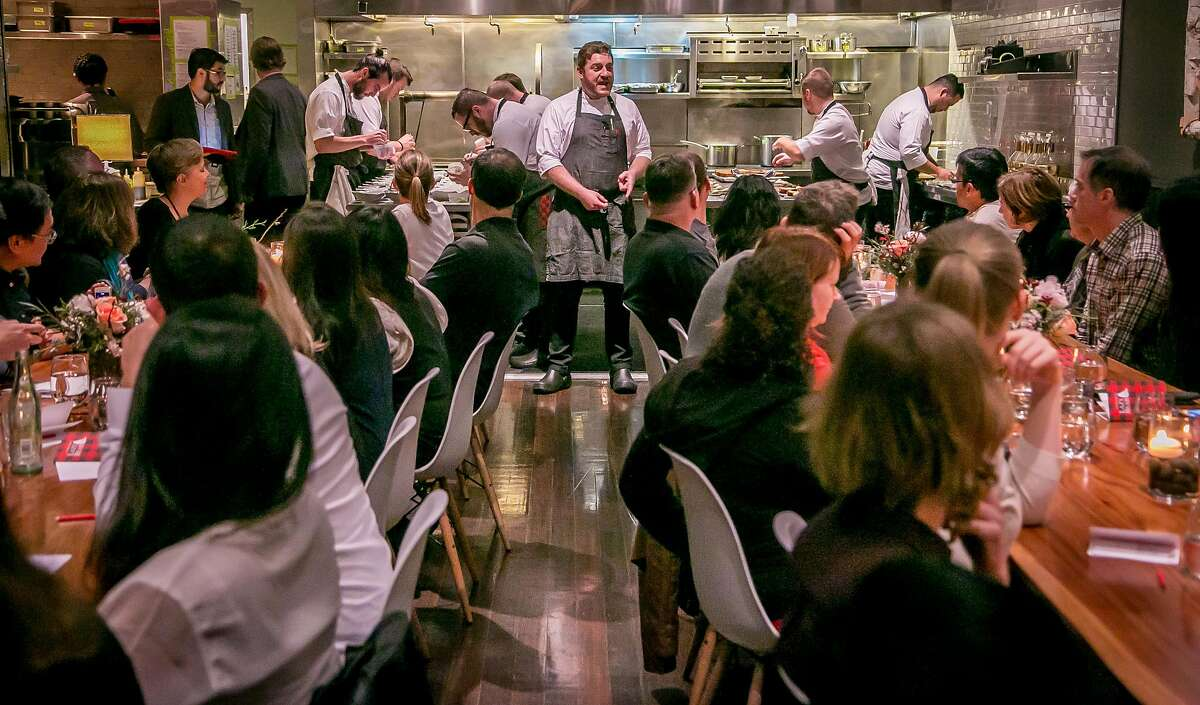 Chef David Barzelay talks with diners before dinner at Lazy Bear in San Francisco, Calif. on December 13th, 2014.