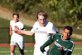 Norwalk's Maicol Ruiz, right, races St. Joseph's Owen Francis to a ball during Monday's FCIAC boys soccer regular season finale between the two schools in Trumbull. Norwalk posted a 6-0 win over the Cadets to clinch a state tournament spot.