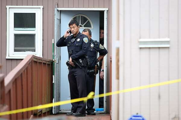 Police guard the door where a possible homicide took place this afternoon on Monday, October 24, 2016, at 137 Addison St.  in San Francisco, Calif.