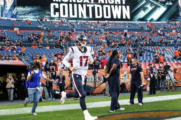 Houston Texans quarterback Brock Osweiler (17) runs onto the field before an NFL football game at Sports Authority Field at Mile High on Monday, Oct. 24, 2016, in Denver.