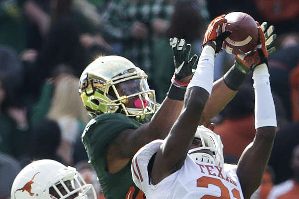 Duke Thomas (21) makes the interception last year that led to a scuffle after Texas players took exception to the way Baylor tackled Thomas.