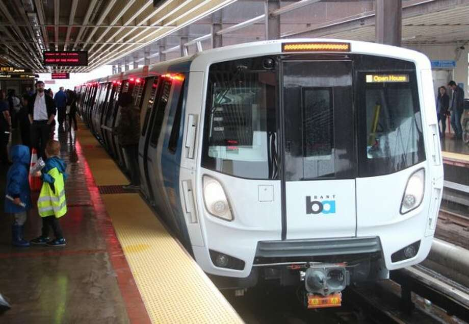 New BART cars were unveiled Sunday at MacArthur Station during an open house event. The cars come equipped with electronic maps and brightly colored seating, among other features.