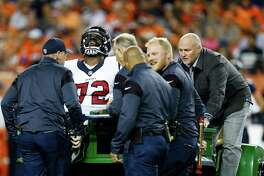 Houston Texans tackle Derek Newton (72) reacts as he is taken off the field with an injury during the first quarter of an NFL football game at Sports Authority Field at Mile High on Monday, Oct. 24, 2016, in Denver.