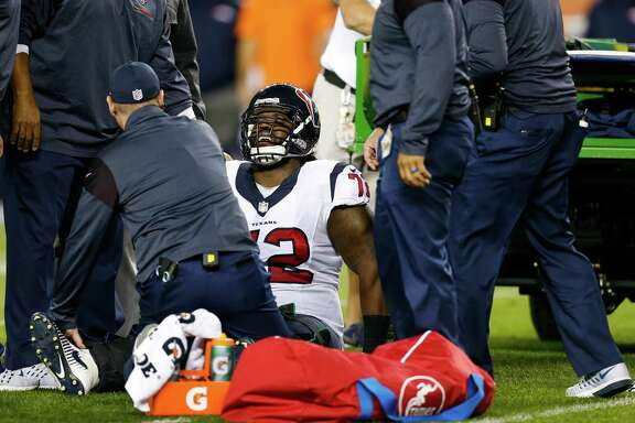 Houston Texans tackle Derek Newton (72) reacts as air casts are put on both of his legs during the first quarter of an NFL football game at Sports Authority Field at Mile High on Monday, Oct. 24, 2016, in Denver.