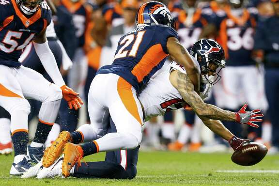 Denver Broncos cornerback Aqib Talib (21) breaks up a pass intended for Houston Texans wide receiver Will Fuller (15) during the first quarter of an NFL football game at Sports Authority Field at Mile High on Monday, Oct. 24, 2016, in Denver.