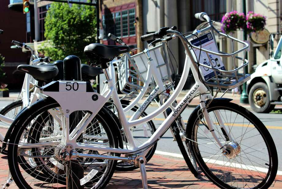 Free bikes for renting as part of the bike share program by the Capital District Transportation Committee are ready for use during a week-long test Thursday, July 10, 2014, on State St. in Schenectady, N.Y.  (Selby Smith/Times Union archive) Photo: Selby Smith / 00027661A