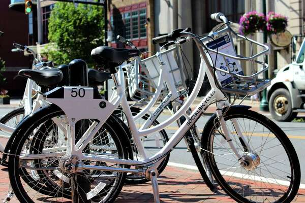 Free bikes for renting as part of the bike share program by the Capital District Transportation Committee are ready for use during a week-long test Thursday, July 10, 2014, on State St. in Schenectady, N.Y.  (Selby Smith/Times Union archive)