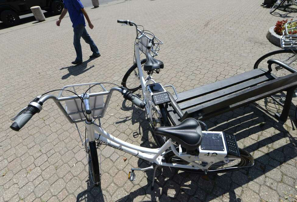 Some of the bicycles available to share during the City's Bikeshare Week are locked to a bench Monday, Aug. 11, 2014, at Tricentennial Square in Albany, N.Y. (Will Waldron/Times Union archive)