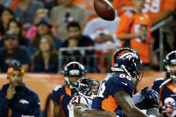 Houston Texans cornerback A.J. Bouye (21) defends pass to Denver Broncos wide receiver Demaryius Thomas (88) during the first quarter of an NFL football game at Sports Authority Field at Mile High on Monday, Oct. 24, 2016, in Denver.