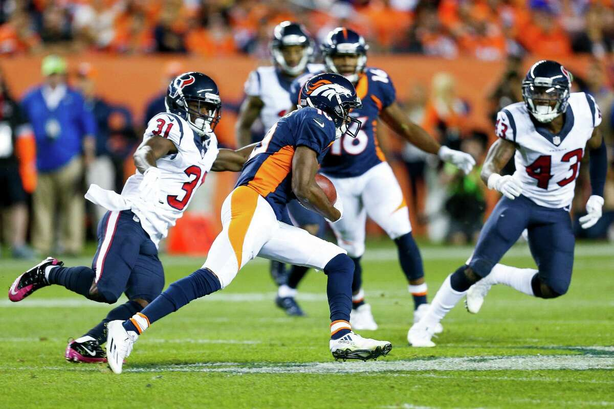 Denver Broncos wide receiver Emmanuel Sanders (10) runs away from a tackle from Houston Texans defensive back Charles James (31) during the second quarter of an NFL football game at Sports Authority Field at Mile High on Monday, Oct. 24, 2016, in Denver.