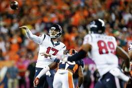 Houston Texans quarterback Brock Osweiler (17) makes a pass during the first quarter of an NFL football game at Sports Authority Field at Mile High on Monday, Oct. 24, 2016, in Denver.