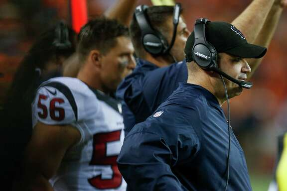 Houston Texans head coach Bill O'Brien watches the field during the first quarter of an NFL football game at Sports Authority Field at Mile High on Monday, Oct. 24, 2016, in Denver.