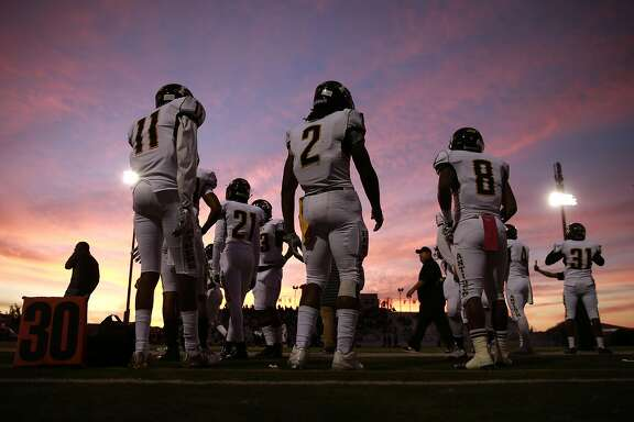 Antioch High School star running back Najee Harris, 2  and his teammates get set to take on the Falcons of Freedom High School on Fri. Oct 7, 2016, in Oakley, California.