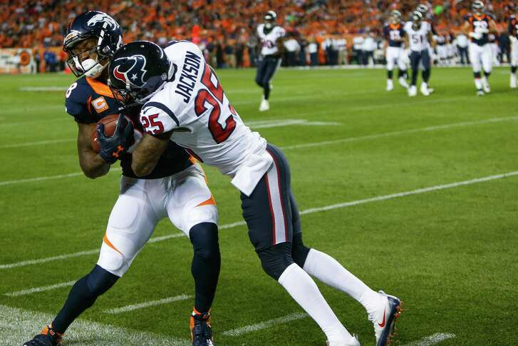 Houston Texans cornerback Kareem Jackson (25) hits Denver Broncos wide receiver Demaryius Thomas (88) out of bounds during the second quarter of an NFL football game at Sports Authority Field at Mile High on Monday, Oct. 24, 2016, in Denver.