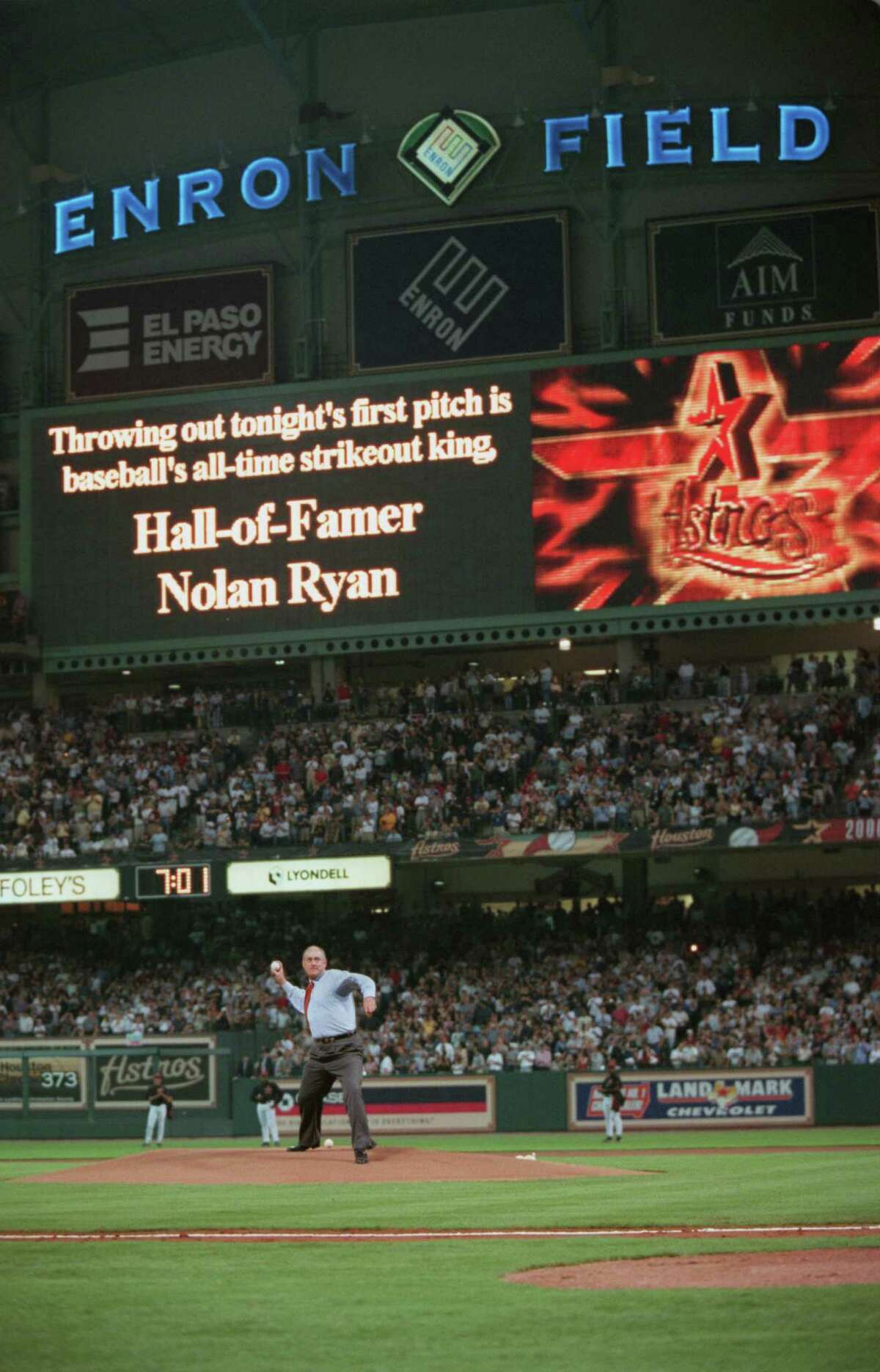 Hall of Famer,and former Astro, Nolan Ryan hurls the first pitch prior to the start of the inaugural game between the Astros and Yankees at Enron Field 3/30/2000. Chronicle/Smiley N. Pool.