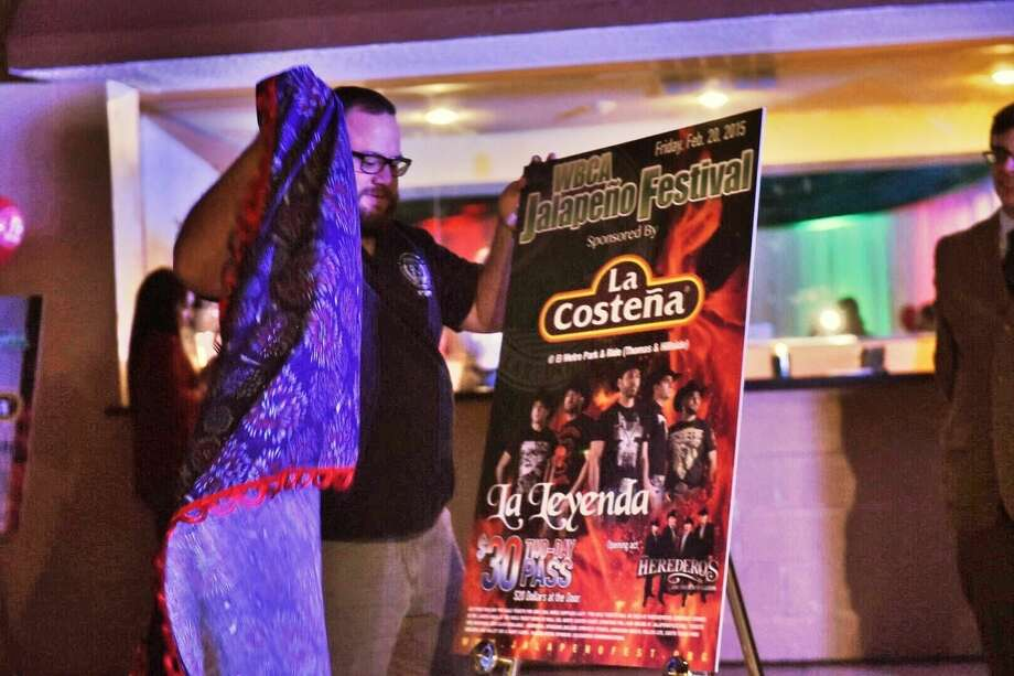 Nino Cardenas unveils a poster Monday at the Casa Blanca Ballroom, revealing the headlining act La Leyenda for the 2015 Jalapeño Festival. Read the full story in Tuesday's newspaper and e-edition. (Photo by Danny Zaragoza/Laredo Morning Times)