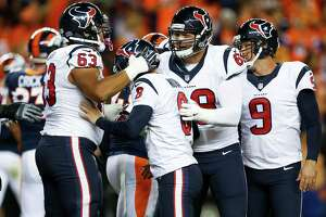 Teammates celebrate with Houston Texans kicker Nick Novak (8) after kicking a field goal during the third quarter of an NFL football game at Sports Authority Field at Mile High on Monday, Oct. 24, 2016, in Denver.