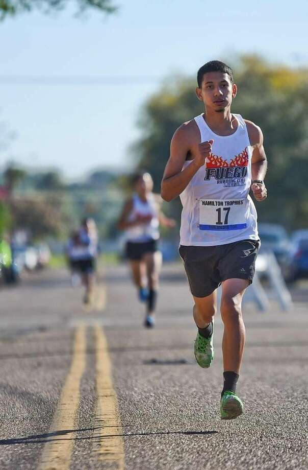 Angel Perez leads other runners down Garden Street on Thursday morning during the 35th Annual Guajolote 10k Race, sponosored by Hamilton Trophies. Perez won third place in this race. Photo by Danny Zaragoza