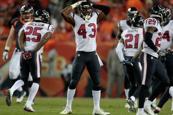 Houston Texans defensive back Corey Moore (43) reacts to a dropped ball during the first half of an NFL football game against the Denver Broncos, Monday, Oct. 24, 2016, in Denver. (AP Photo/Joe Mahoney)