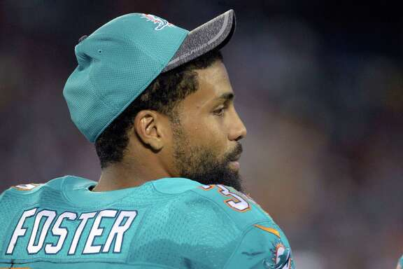 Miami Dolphins running back Arian Foster (34) watches from the sideline during the second half of an NFL preseason football game against the Atlanta Falcons in Orlando, Fla., Thursday, Aug. 25, 2016. The Dolphins won 17-6. (AP Photo/Phelan M. Ebenhack)
