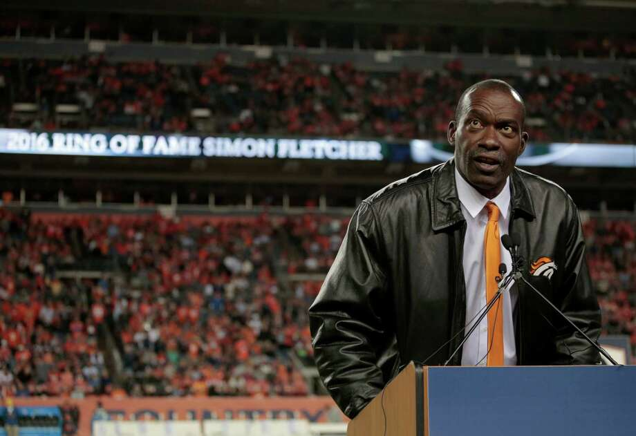 Former Denver Broncos' Simon Fletcher speaks after being inducted into the Broncos ring of honor at half time of an NFL football game against the Houston Texans, Monday, Oct. 24, 2016, in Denver. (AP Photo/Joe Mahoney) Photo: Joe Mahoney, Associated Press / FR170458 AP