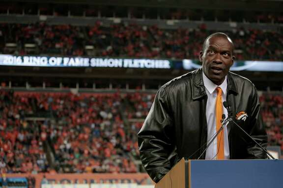 Former Denver Broncos' Simon Fletcher speaks after being inducted into the Broncos ring of honor at half time of an NFL football game against the Houston Texans, Monday, Oct. 24, 2016, in Denver. (AP Photo/Joe Mahoney)