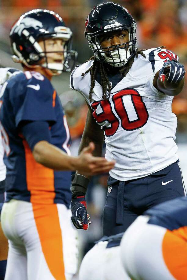 Houston Texans defensive end Jadeveon Clowney (90) signals to his teammates during the third quarter of an NFL football game at Sports Authority Field at Mile High on Monday, Oct. 24, 2016, in Denver. Photo: Brett Coomer, Houston Chronicle / © 2016 Houston Chronicle