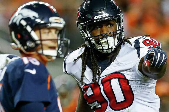 Houston Texans defensive end Jadeveon Clowney (90) signals to his teammates during the third quarter of an NFL football game at Sports Authority Field at Mile High on Monday, Oct. 24, 2016, in Denver.