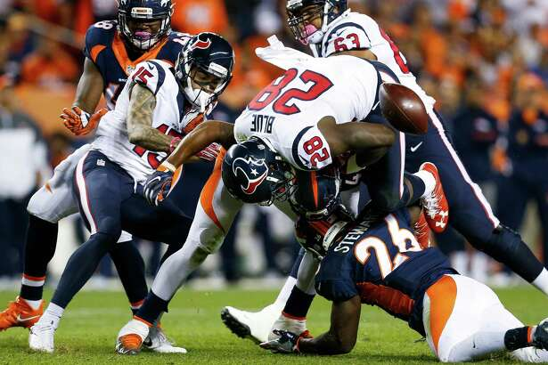 Houston Texans running back Alfred Blue (28) fumbles the ball after a hit by Denver Broncos free safety Darian Stewart (26) during the third quarter of an NFL football game at Sports Authority Field at Mile High on Monday, Oct. 24, 2016, in Denver. Denver recovered the fumble.