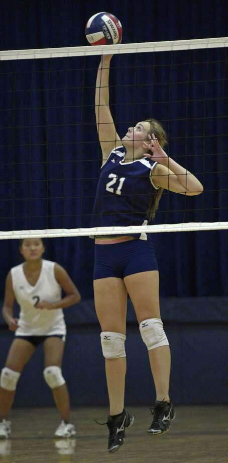 FILE PHOTO: Immaculate's Rachel Hewitt (21) goes up for the spike in the girls high school volleyball match between Henry Abbott Technical and Immaculate high school on Wednesday afternoon, September 23, 2015, at Immaculate High School, in Danbury, Conn. Photo: H John Voorhees III / Hearst Connecticut Media / The News-Times