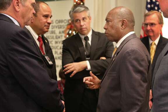 Houston mayor Sylvester Turner speaks with members of the Houston Police Department pension system following the announcement of an agreement between the city and all three employee pension systems to reform the city's pension system during a press conference at City Hall, Monday, Oct. 24, 2016, in Houston.