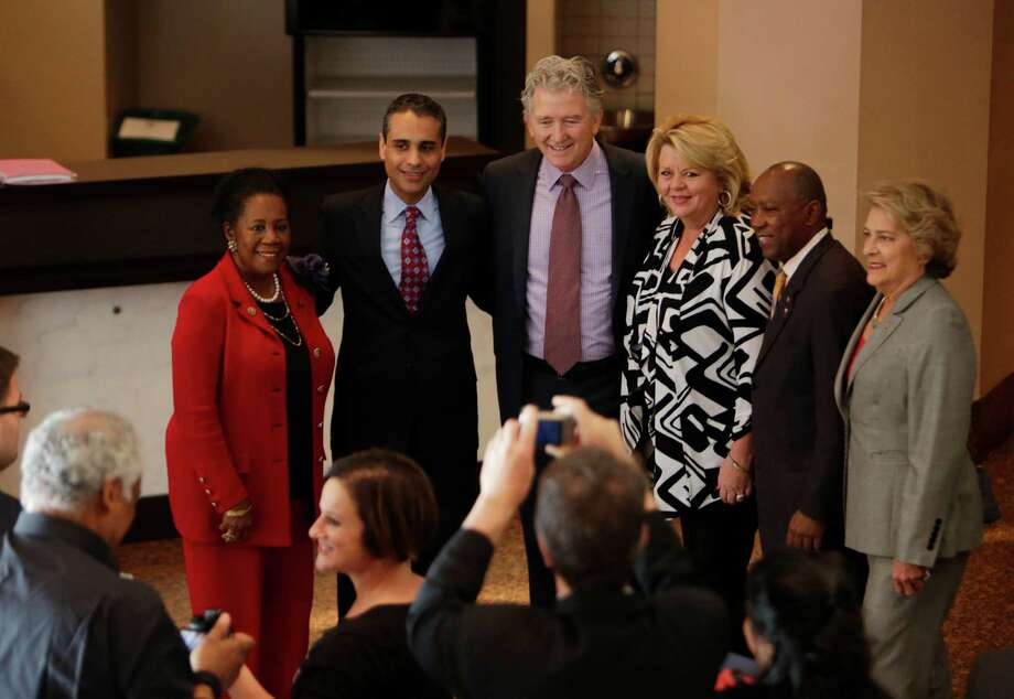 "Screenwriter Siddharth Kara, second from right, and actor Patrick Duffy take pictures with Congresswoman Sheila Jackson Lee, left, City Councilwoman Brenda Stardig, Mayor Sylvester Turner and City Councilwoman Ellen Cohen before a screening of the film ""Trafficked"" at the Wortham Center on Monday. Photo: Houston Chronicle / © 2016 Houston Chronicle"