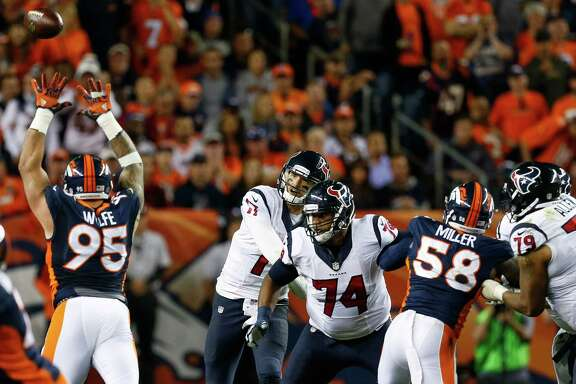 Houston Texans quarterback Brock Osweiler (17) loses control of the ball as he attempts to make a pass, resulting in a fumble recovered by the Denver Broncos during the fourth quarter of an NFL football game at Sports Authority Field at Mile High on Monday, Oct. 24, 2016, in Denver.