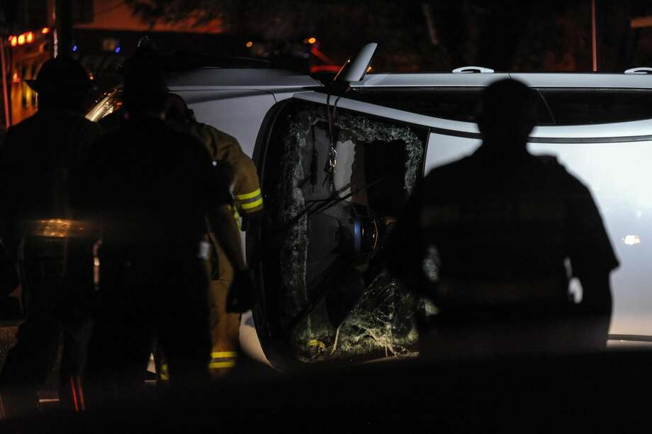 'No injuries'Firefighters work at the scene of a vehicle rollover near the corner of North Canada Avenue and Market Street on Thursday night. No injuries reported, and it wasn't clear late Thursday how the accident occurred. (Photo by Danny Zaragoza/Laredo Morning Times)
