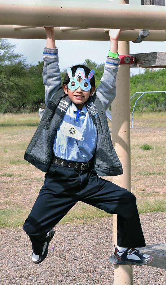 Farias Elementary student Jose Joel Mijares wears a bunny mask as he swings from the monkey bars Wednesday morning at Lake Casa Blanca International State Park during the 3rd Annual Autism Awareness Fun Day. (Photo by Cuate Santos/Laredo Morning Times)