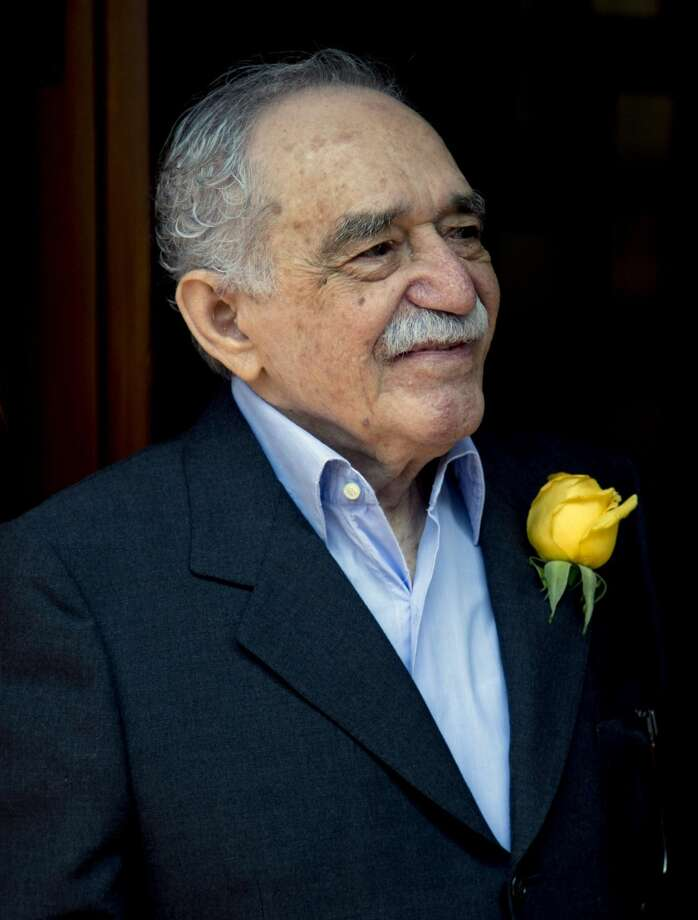 In this March 6, 2014 file photo, Colombian Nobel Literature laureate Gabriel Garcia Marquez greets fans and reporters outside his home on his 87th birthday in Mexico City. Marquez died Thursday April 17, 2014 at his home in Mexico City. (AP Photo/Eduardo Verdugo, File)