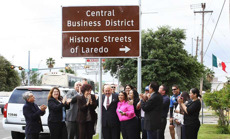 Officials from the city, TxDOT and Laredo Main Street clap after unveiling the Central Business District Historic Streets of Laredo sign Thursday morning. (Photo by Gabriela Treviño/Laredo Morning Times)
