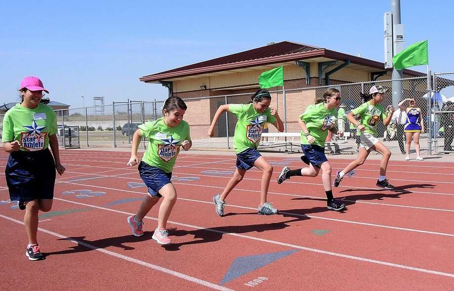 A group of female athletes compete in the 50M race at UISD's Student Activity Complex, as they participated in the Area 21 Special Olympics Tuesday morning. (Cuate Santos/Laredo Morning Times)