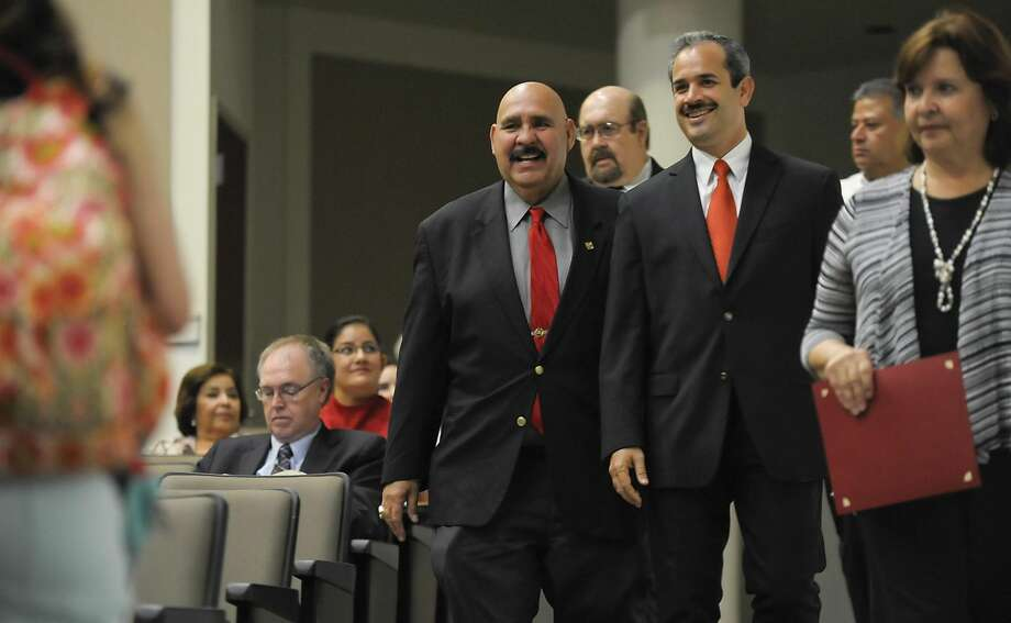 Mayor Raul Salinas, left, and former Nuevo Laredo Mayor Benjamin Galván Gomez walks into a classroom at the TAMIU Student Center on Sept. 10, 2013, where Galván would give his State of the City address. Gauging reaction to Galván's death from the Nuevo Laredo residents is not easy, as residents exhibit fear and suspicion about his death. (File photo by Danny Zaragoza/Laredo Morning Times)